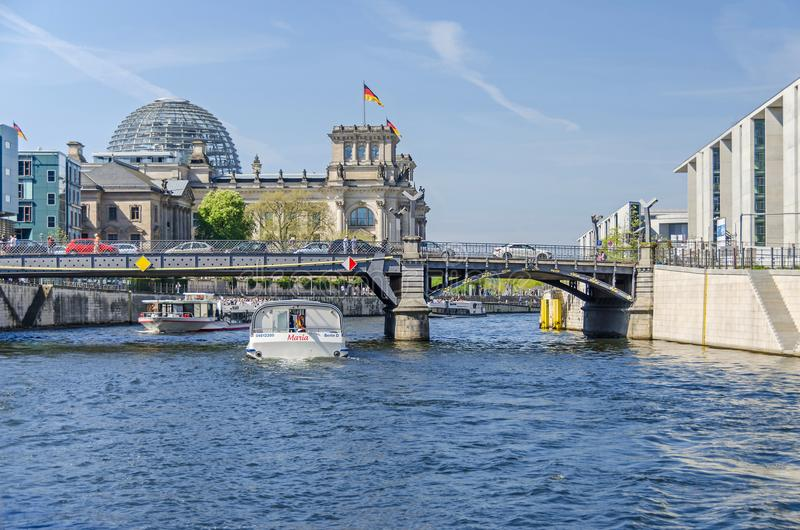 River Spree with tourist boats, the bridge Marschallbruecke, Reichstag, Paul-Loebe House and Marie-Elisabeth-Lueders House. Berlin, Germany - April 22, 2018 stock photo