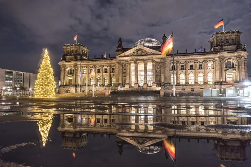Berlin, Germany. the architecture of the Reichstag building with a Christmas tree in the night royalty free stock images