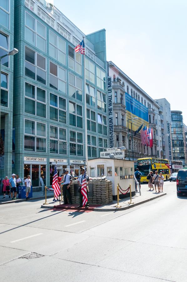 Checkpoint Charlie in Berlin with men in soldiers uniform. royalty free stock image