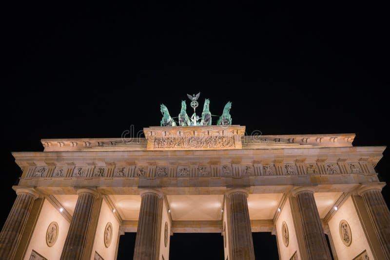 Historic Brandenburg Gate illuminated at night stock image