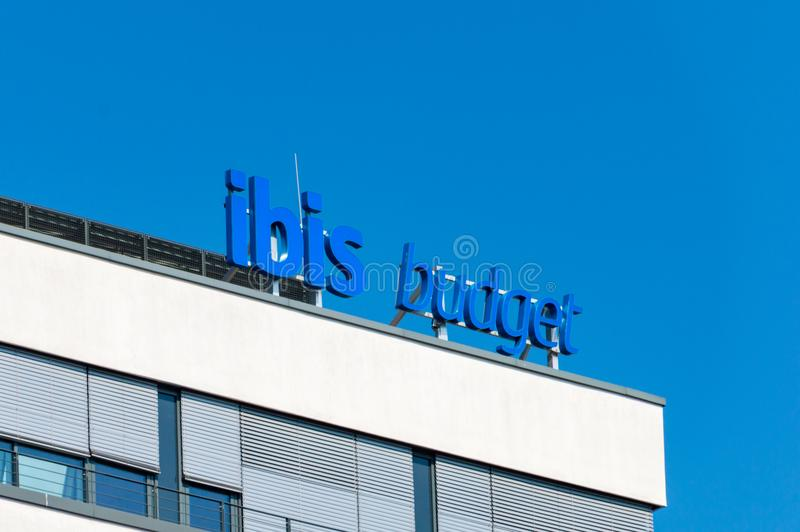 Ibis budget hotel sign on the roof. royalty free stock image