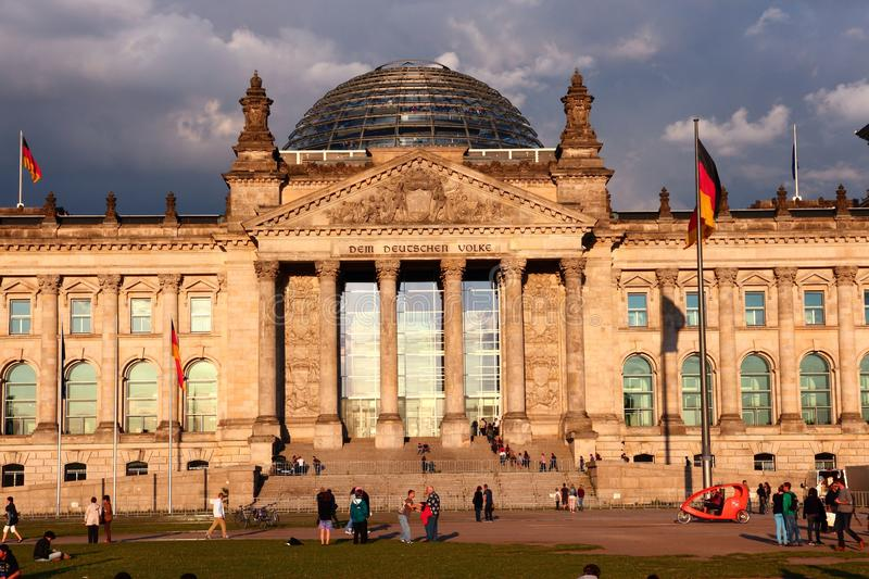 Berlin Germany. BERLIN, GERMANY - AUGUST 27, 2014: People visit Reichstag building in Berlin. Berlin is Germany\'s largest city with population of 3.5 million royalty free stock photo