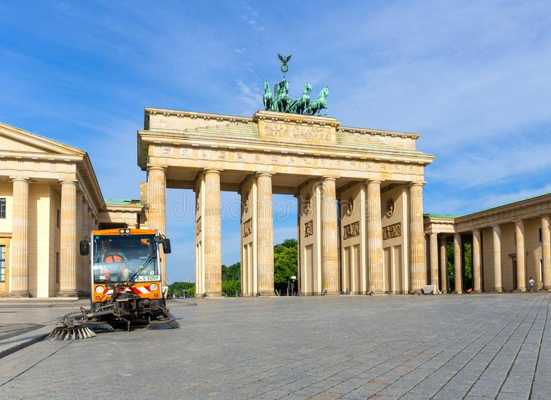 Sweeper of the Berlin city purification in front of the Brandenburg Gate royalty free stock images