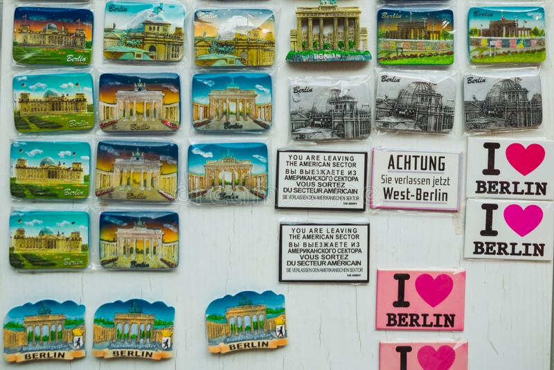 BERLIN, GERMANY: Colorful magnets. A stall selling traditional german souvenir in Berlin. BERLIN, GERMANY: A stall selling traditional german souvenir in Berlin royalty free stock photos