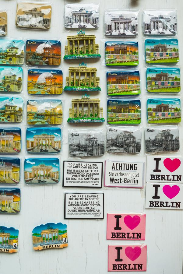 BERLIN, GERMANY: Colorful magnets. A stall selling traditional german souvenir in Berlin. BERLIN, GERMANY: A stall selling traditional german souvenir in Berlin royalty free stock image