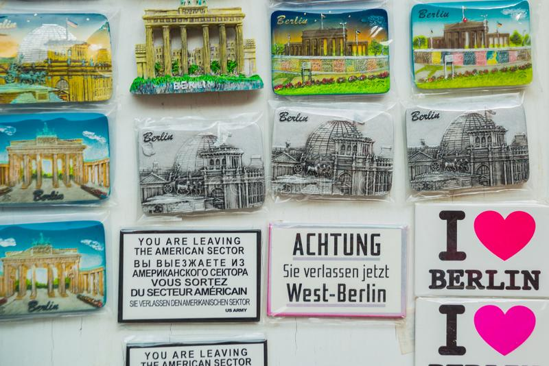 BERLIN, GERMANY: Colorful magnets. A stall selling traditional german souvenir in Berlin. BERLIN, GERMANY: A stall selling traditional german souvenir in Berlin stock image