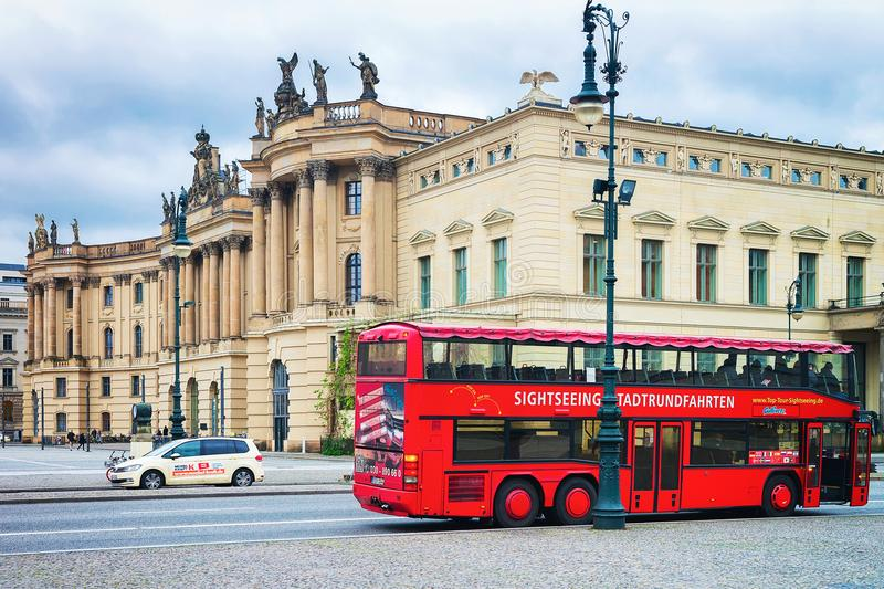 Red excursion bus at Humboldt University in Berlin royalty free stock photography