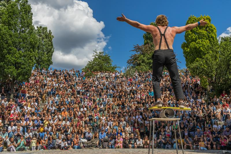 Street artist and acrobats, Mauerpark. Berlin. Berlin, Germany - famous for its Sunday market, the Mauerpark is also a great opportunity for skilled street royalty free stock images