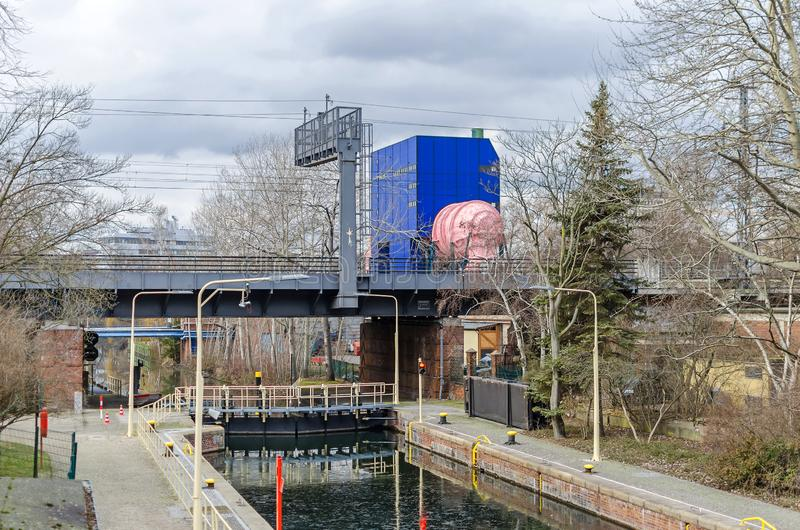 Landwehr Canal with its Lower Lock and a pink pipe of the circulating channel in Berlin, Germany. Berlin, Germany - January 31, 2019: The Landwehr Canal, or royalty free stock photography