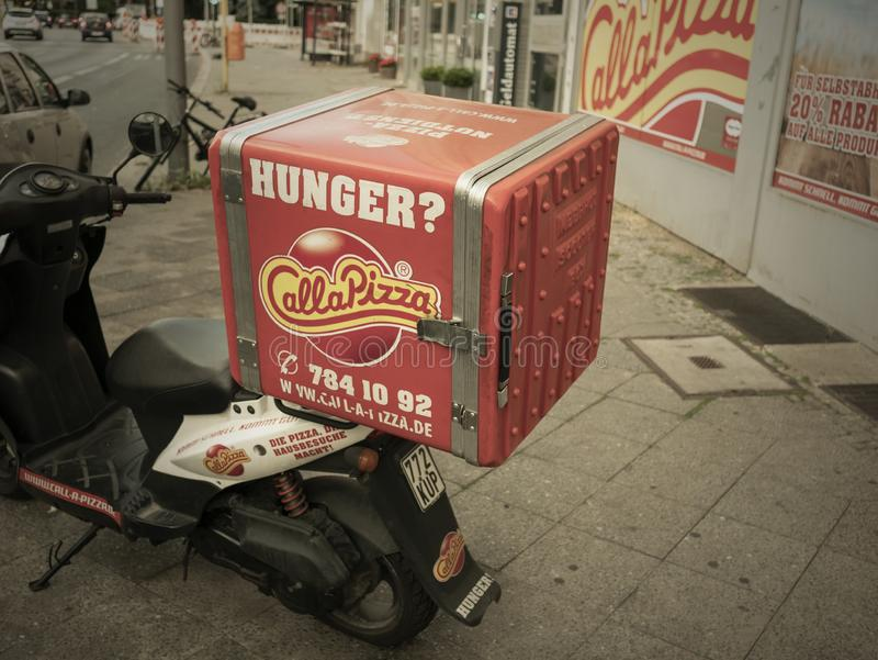 Motorcycle With Delivery Box of Call A Pizza Food Delivery Service In Berlin stock image