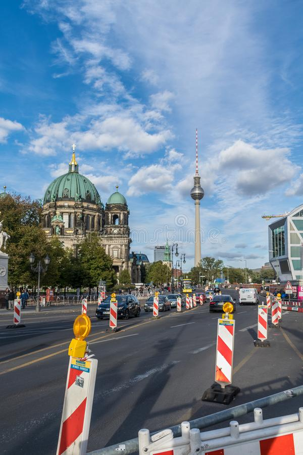 BERLIN, GERMANY - July 28, 2018: Perspective from a busy half-closed avenue with street signs near the ancient Berliner. Dom and the TV tower two great tourist royalty free stock photography