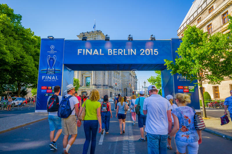 BERLIN, GERMANY - JUNE 06, 2015: Blue big signal of the final match on Berlin, Champions league 2015. People walking. Trought stock photos