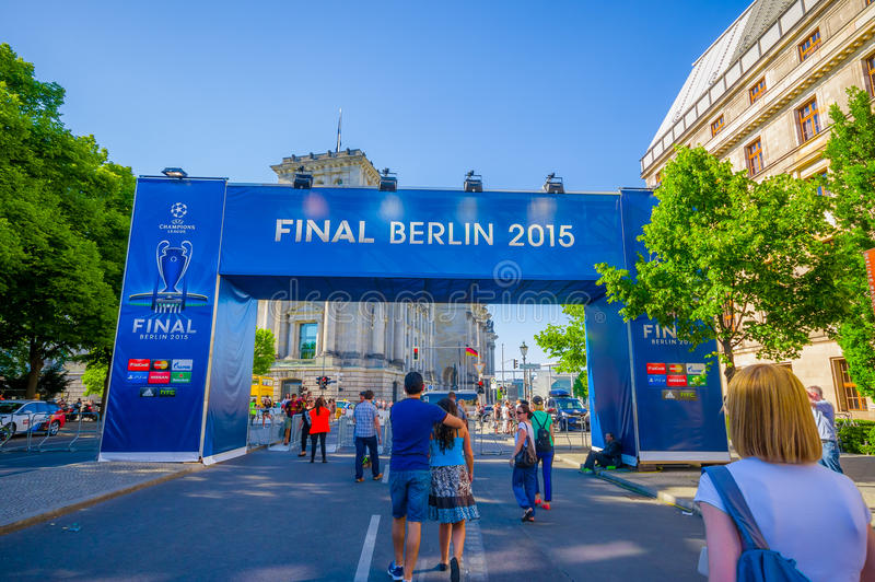 BERLIN, GERMANY - JUNE 06, 2015: Blue big signal of the final match on Berlin, Champions league 2015. People walking. Trought stock image