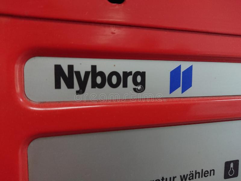 Electric Tumble Dryer, detail. Berlin, Germany - June 25, 2018: Nyborg emblem on a tumble dryer manufactured by the Swedish company Electrolux Laundry Systems royalty free stock photos