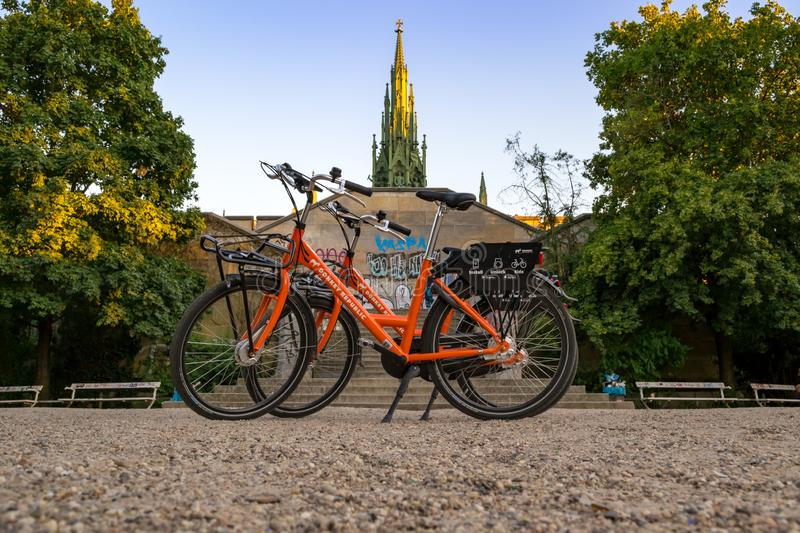 Berlin / Germany - 29 June 2018: Two hired bikes in front of the Prussian Monument for the Liberation Wars royalty free stock image