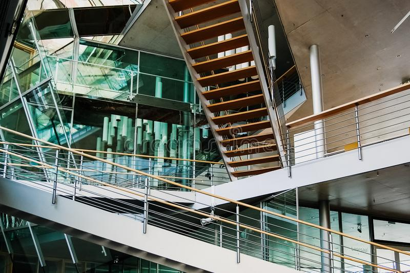 Berlin, Germany - June 1, 2019: Stairs that intersect inside an architectural design building with transparent crystals royalty free stock photos