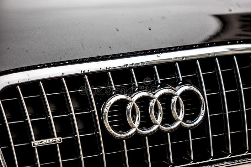 Audi car emblem. Berlin, Germany - March 23, 2018: Audi company emblem. Audi AG is a premium German automobile manufacturer that designs, engineers, produces stock photos