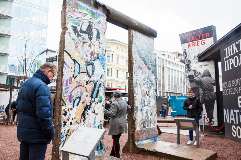Tourists looking at a piece of the Berlin Wall at the entrance of the BlackBox Cold War Museum stock photo