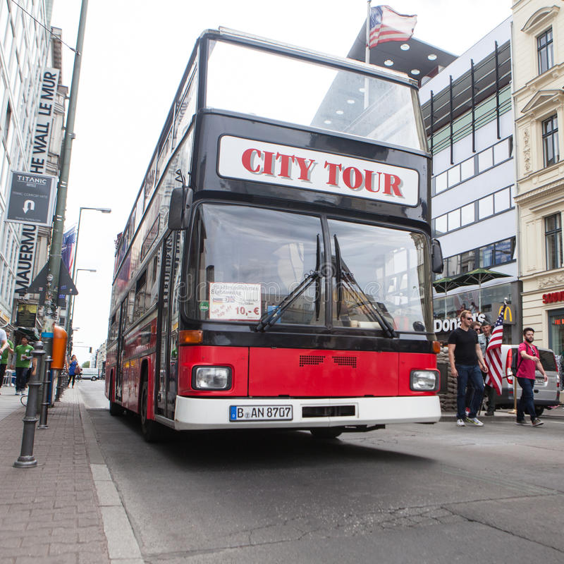 BERLIN, GERMANY - MAY 10, 2015: Bus at Checkpoint Charlie. The crossing point between East and west Berlin became a symbol of the stock images