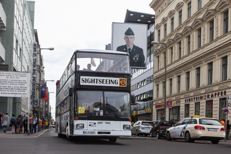 BERLIN, GERMANY - MAY 10, 2015: Bus at Checkpoint Charlie. The crossing point between East and west Berlin became a symbol of the stock photography