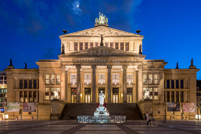 Berlin, Germany - May 11, 2016: Concert Hall on the Gendarmenmarkt, a girl on bicycle looking at the building. Gendarmenmarkt is a favourite spot for prominade royalty free stock image