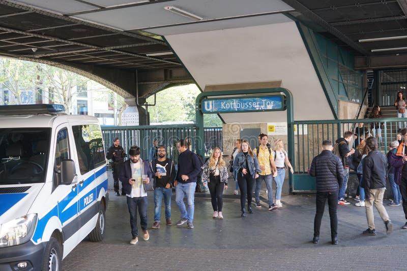 May 1, International Workers` Day in Berlin Kreuzberg. Berlin, Germany - May 1, 2019: Crowd of people outside the Kottbusser Tor U-bahn station, Kreuzberg royalty free stock images