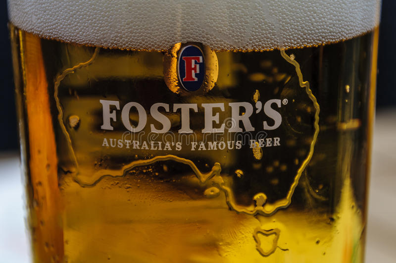 BERLIN, GERMANY, May 10 2016, Foster's logo on beer glass. Close up of a glass of Foster's with foam stock image