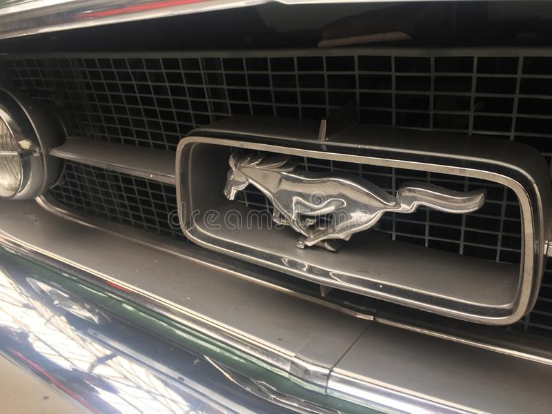 Front emblem of a Ford Mustang vintage car royalty free stock photography