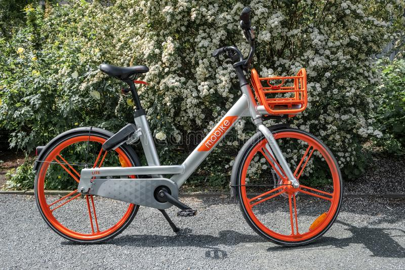 Mobike bicycle on a street Berlin, Germany. Mobike was created by Beijing Mobike Technology Co., Ltd. stock photography