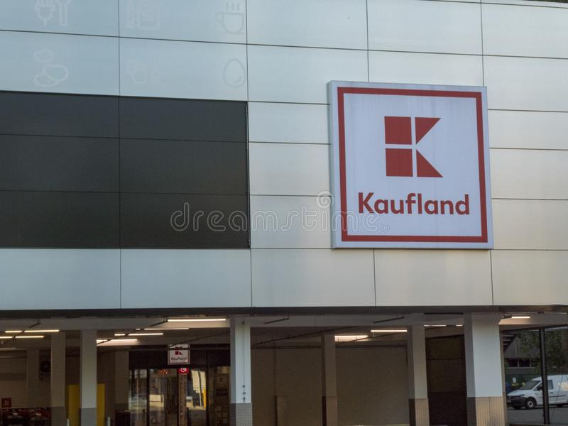Kaufland hypermarket signage. Berlin, Germany - May 8, 2018: Signage of Kaufland, German hypermarket chain, part of the Schwarz Gruppe which also owns Lidl and royalty free stock image