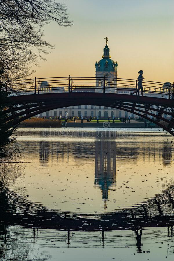 Bridge crossing the Lake of Charlottenburg Palace. Berlin, Germany- november 16, 2018: Bridge crossing the Lake of Charlottenburg Palace in evening sunshine royalty free stock photography