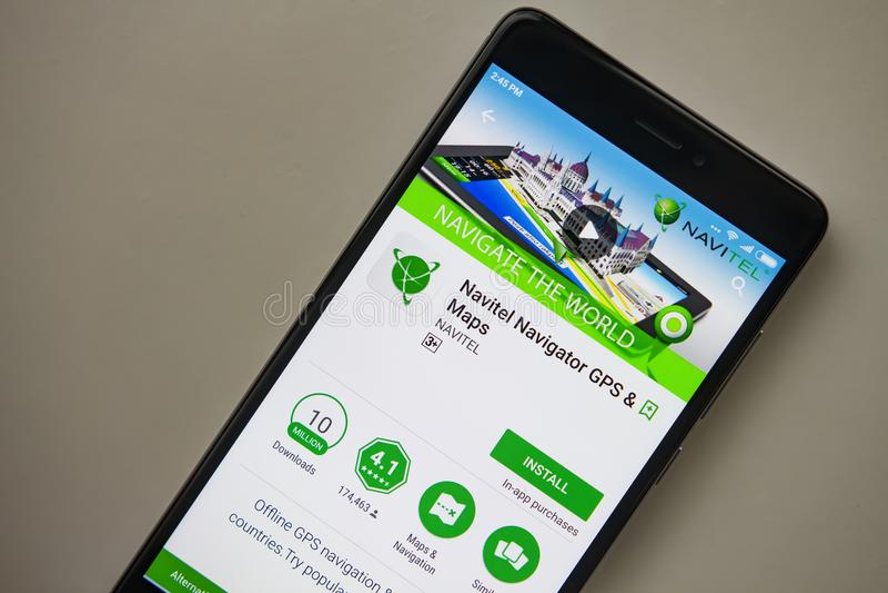 Berlin, Germany - November 19, 2017: Navitel application on screen of modern smartphone close-up royalty free stock image