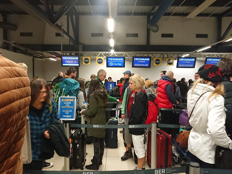 People in a row to board a Ryanair flight stock photos