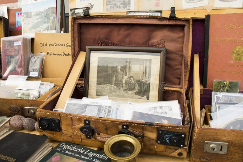 BERLIN, GERMANY - OCTOBER 14, 2017: Open air shop on the street, old antique box and photos, books and old postcards. Flea market. In Berlin stock photos
