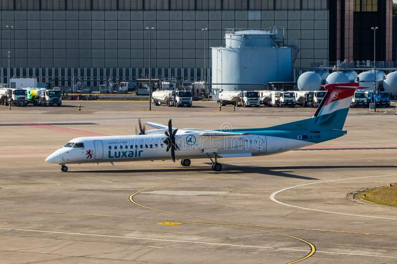 Berlin, Germany, September 8, 2018: Bombardier Dash 8 Q400 by Luxair at Tegel airport in Berlin royalty free stock images