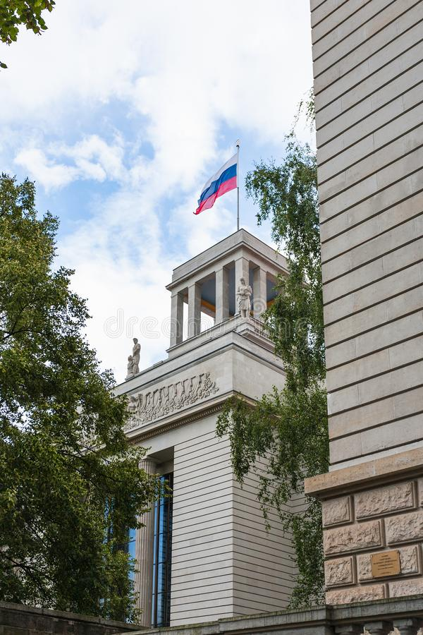 Flag on top of Embassy of the Russian Federation. BERLIN, GERMANY - SEPTEMBER 13, 2017: state flag on top of Embassy of the Russian Federation in Germany on royalty free stock photo