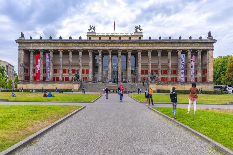 Berlin, Germany, 10th July, 2018. Museum island, approach route of gravel with visitors, to one of the many museums. On the grass stock image