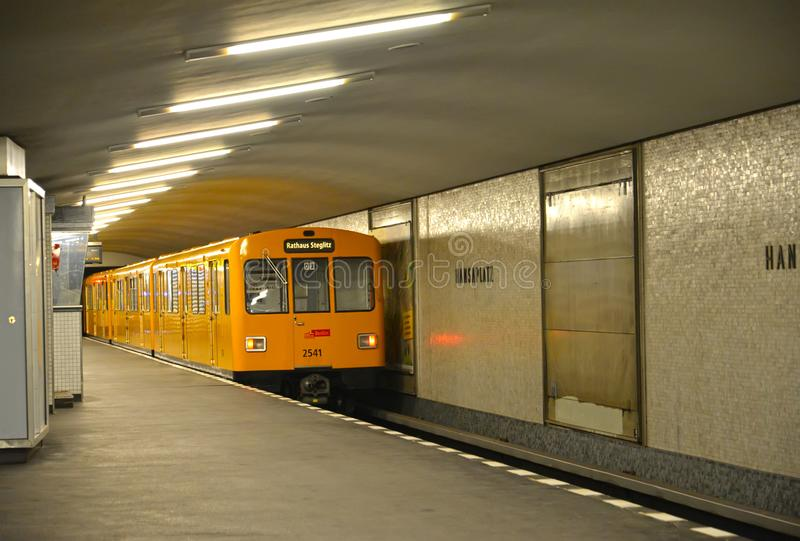 BERLIN, GERMANY. The train drives of from the platform of the station of the Hanzaplatz subway. BERLIN, GERMANY - AUGUST 12, 2017: The train drives of from the stock photos