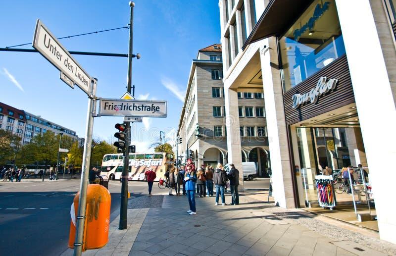 Berlin city centre Unter den Linden crossroads. Berlin Germany - Unter den Linden and Friedrichstrasse crossroads with Douglas shop stock photos