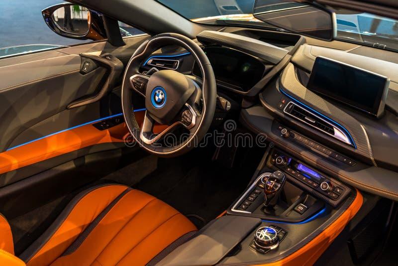 Interior of a plug-in hybrid sports car BMW i8 Roadster. BERLIN - JUNE 09, 2018: Showroom. Interior of a plug-in hybrid sports car BMW i8 Roadster stock images