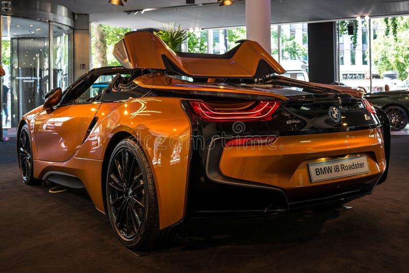 A plug-in hybrid sports car BMW i8 Roadster. BERLIN - JUNE 09, 2018: Showroom. A plug-in hybrid sports car BMW i8 Roadster. Rear view stock image
