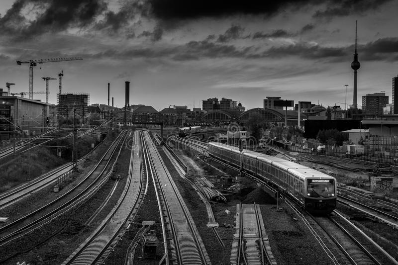 Berlin metro railway tracks with TV Tower in background.  stock photos