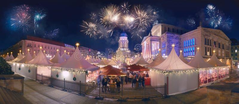 Fireworks over Iluminated Christmas market at Gandarmenmarkt in royalty free stock images