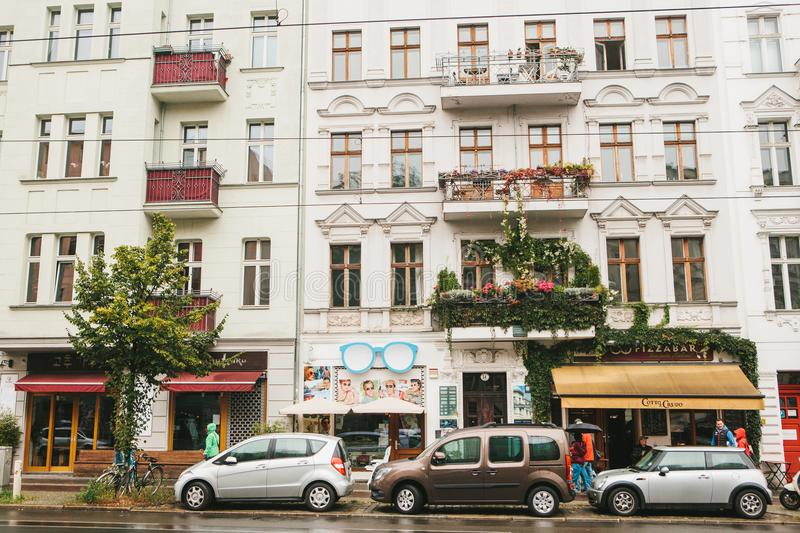 Berlin, October 1, 2017: Beautiful authentic houses with decorated balconies, shops and cafes with people and cars royalty free stock photos