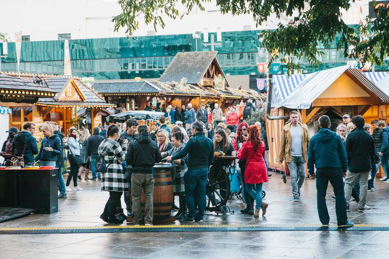 Berlin, October 03, 2017: Celebrating the Oktoberfest. People walk on the street market on the famous Alexanderplatz stock image