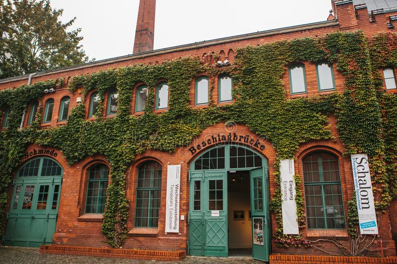 Berlin, October 1, 2017: Facade of the museum building is made of red brick with announcements about exhibitions and stock images