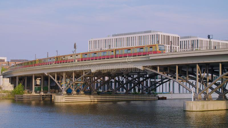 Railway Bridge Over River. Berlin Public Train Passing From Left To Right Over A Modern Railway Bridge Over The River Spree On A Sunny Summer Day. Inner City royalty free stock images