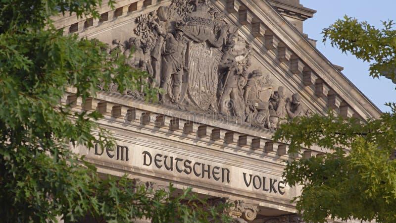 Berlin German Parliament Reichstag Inscription. Berlin Reichstag. German Parliament Building Front Facade Detail. Streetview With Trees. Dem Deutschen Volke royalty free stock photography