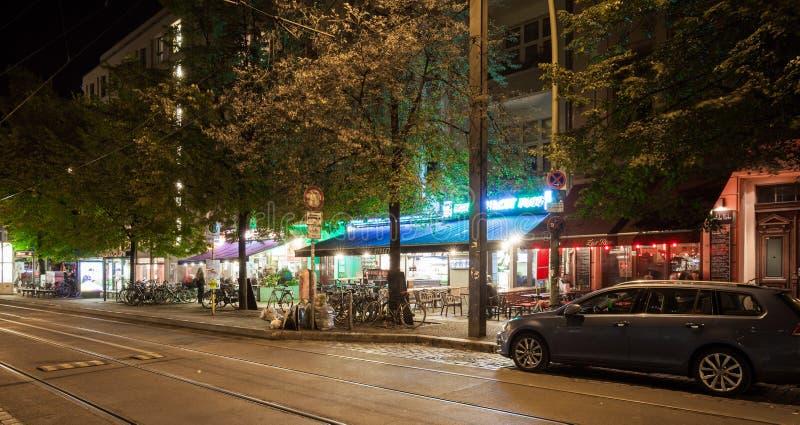 Berlin Rosenthaler Platz cafes at night. BERLIN - October 8, 2016: The cafes and bars at Rosenthaler Platz (Rosenthal Square) in Berlin's Prenzlauer Berg on the royalty free stock photo