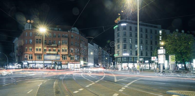 Berlin Rosenthaler Platz at night. BERLIN - October 8, 2016: Traffic moves through Rosenthaler Platz (Rosenthal Square) in Berlin on the night of October 8, 2016 stock image